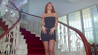 Gorgeous ginger spoil Agatha is posing on the stairway