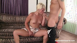 MILF pleases younger lad with blowjob and smashing sex