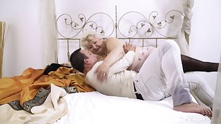 Mature short haired granny Astrid gets a cumshot on huge natural tits