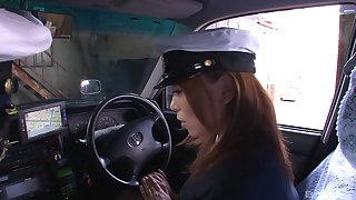 Japanese brunette taxi driver sucks her colleague's dick on a break