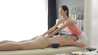 Brunette Emma L gives a massage before getting fucked and cum sprayed