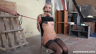 Blonde Victoria Pure tied up and abused on a chair in stockings