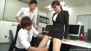 Japanese babe fucked and eats cum off of two cocks in the office