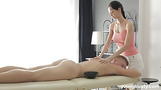Slender masseuse with obese tits Emma L gets intimate with one be advantageous to her clients